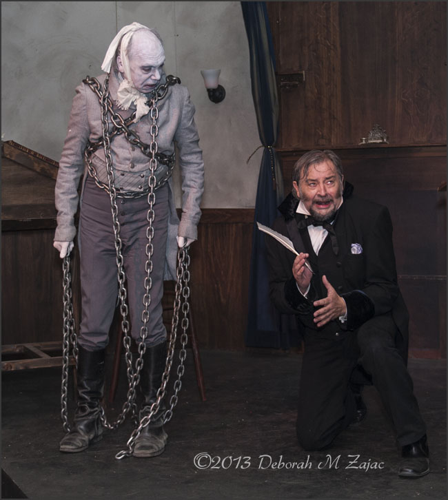 The Ghost Jacob Marley warns Ebenezer Scrooge of the awful fate