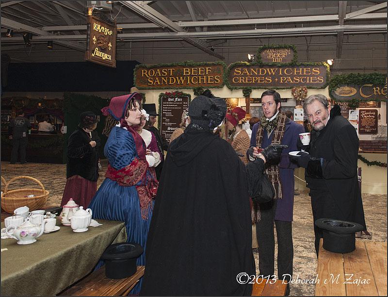 Ebenezer Scrooge and Bob Cratchit taking a spot o'tea