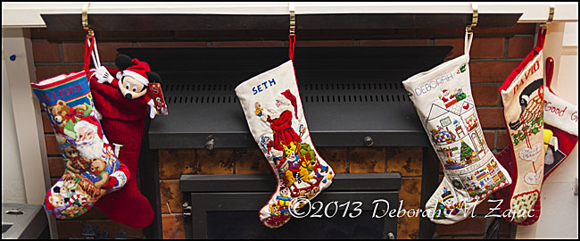 The Stockings were hung by the Chimney with care.