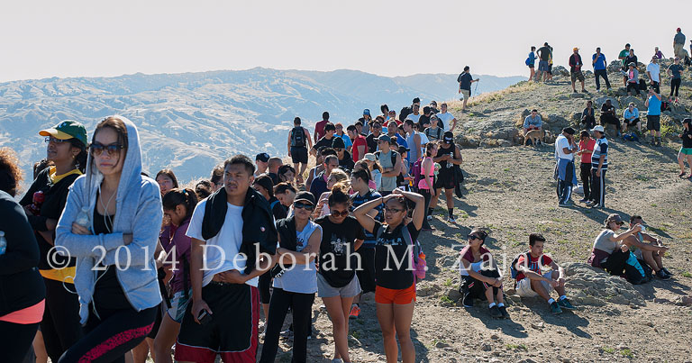 Line of hikers to Mission Peak Pole waiting to take their photo