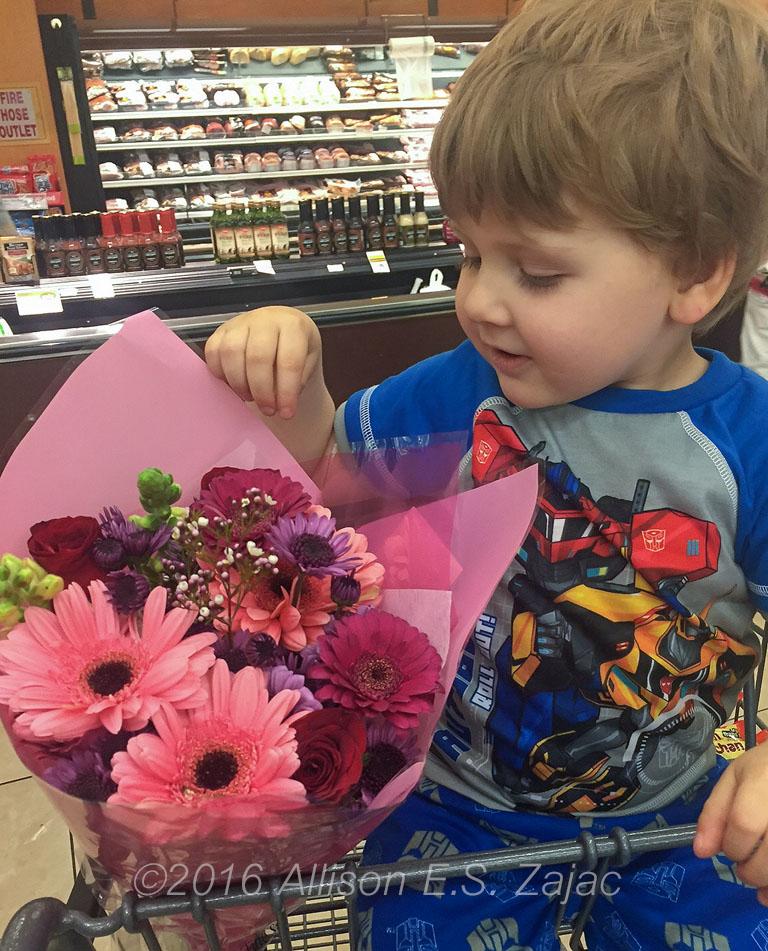 Jaxon with Bouquet for Grandma