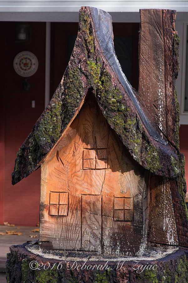 Carved house from tree stump