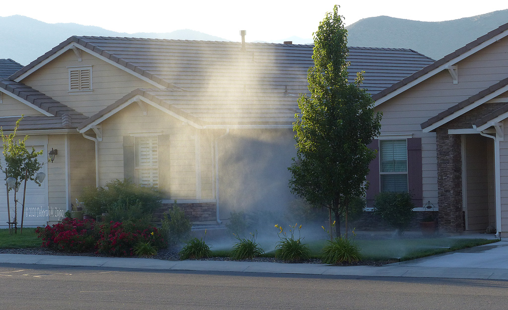 Sunlight on the sprinkler Mist